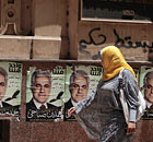 Posters of Hamdeen Sabahy plaster a wall in Cairo
