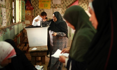 Egyptian women cast their votes inside a polling station in Cairo