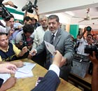Egyption presidential candidate Mohamed Mursi prepares to vote