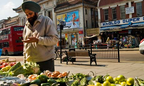 Sikh man at a fruit and veg stall in London
