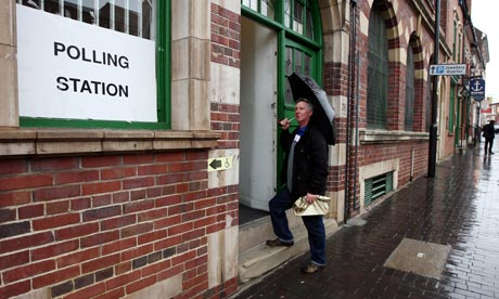 A man arrives at a polling station in Birmingham to vote on whether to have a city mayor