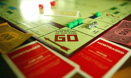 A Monopoly board with mortgage cards