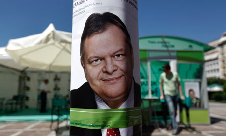 Socialist PASOK party Venizelos is seen on a pole in front of a campaign kiosk in Athens