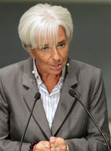 Christine Lagarde gestures as she speaks during an international conference in Riga