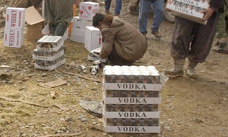 Iranian Kurdish men smuggle alcohol from Iraq to Iran, where liquor is banned