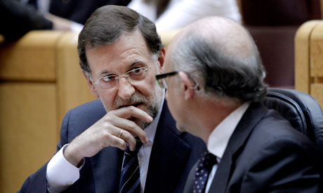 Spain's prime minister Mariano Rajoy (left) chats with the treasury minister, Cristobal Montoro