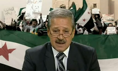 Syria's ambassador to Iraq Nawaf al-Fares annoucing his defection
