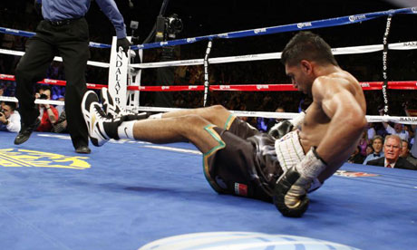 Amir Khan on the canvas after being knocked down by Danny Garcia
