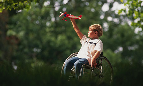 Boy in Wheelchair with Toy Airplane