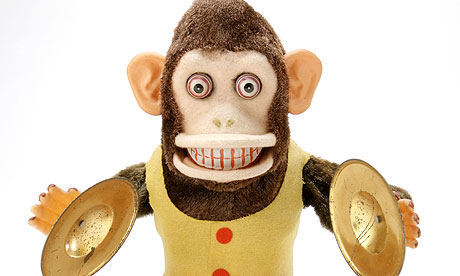 An antique childrens toy monkey that make noise
