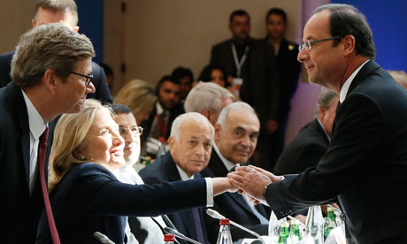 France's President Francois Hollande shakes hands with US Secretary of State Hillary Clinton