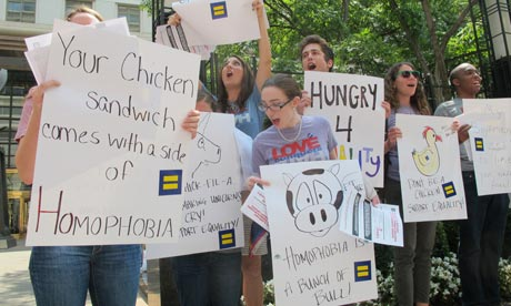 Gay rights protesters hold signs at chick-fil-a
