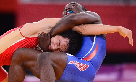 Thomas Spencer Mango from United States of America (BLUE) wrestles with Mingiyan Semenov from Russia (RED) in their 55kg Greco-Roman wrestling match. Larry W. Smith/EPA
