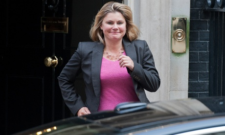 Looking pretty pleased Justine Greening leaves No 10 Downing Street after meeting with  David Cameron to receive her new appointment as international development secretary in Cameron's first cabinet reshuffle.