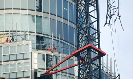 The damaged crane that was hit by a helicopter  before crashing in Vauxhall, London.