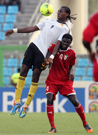 African Nations: Manucho of Angola fights for the ball with Nagm Eldim of Sudan