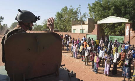 A French soldier waves from his armoured vehicle in Mali on operation 'Serval'