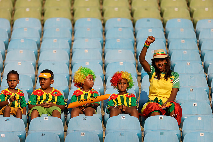 24 hours in pictures: An Ethiopia supporter reacts as the players enter the pitch