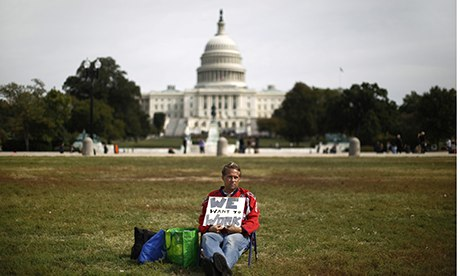 Furloughed Americorps employee Wismer sits alone on the Washington Mall