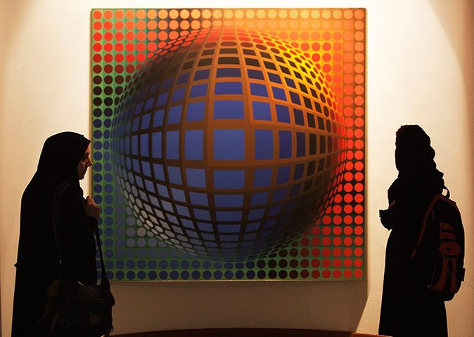 Iran Tourism Push: Visitors look at an artwork by Victor Vasarely at Tehran's Museum of Contem