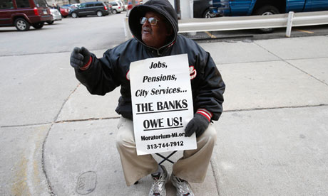 City of Detroit pensioner Donald Smith sits across the street from the Federal Court House, to protest cuts in city workers' pensions., From ImagesAttr