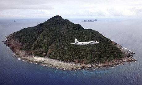 A Japanese patrol plane flies over the disputed Senkaku islands in the East China Sea