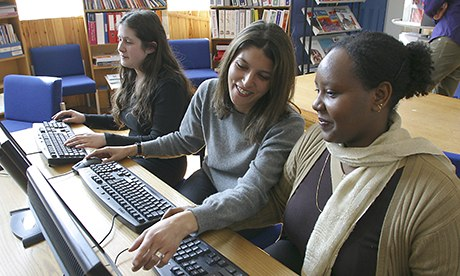 Mature female students in computer class at adult education centre FE Camden London