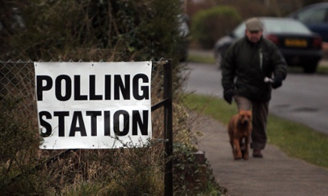 A man arrives with his dog at a polling station to cast his vote in the by-election in Eastleigh, Hampshire.