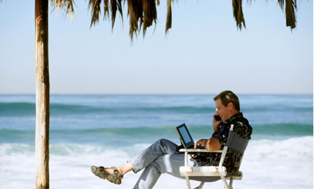 Using Cell Phone and Laptop on Tropical Beach