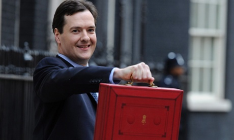 George Osborne holds his red box outside 11 Downing Street before delivering last year's budget.