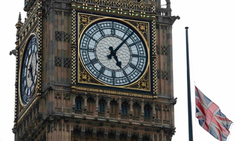 A Union flag flies at half mast over the Houses of Parliament, and next to the Big Ben clock tower, after the announcement of the death of Lady Thatcher.