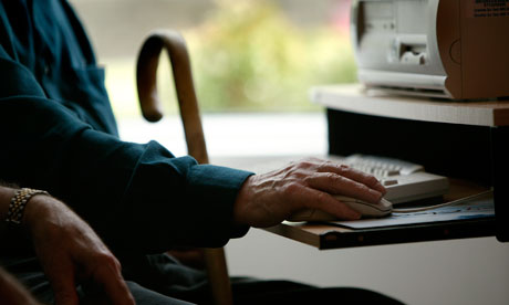 Elderly person using computer