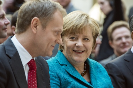 German Chancellor Angela Merkel and Polish Prime Minister Donald Tusk talking before the conference.