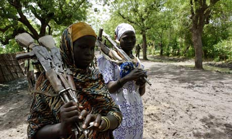 Southern Sudanese women carry weapons