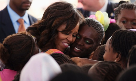 Michelle Obama hugs students at Martin Luther King middle school in Dakar, Senegal.