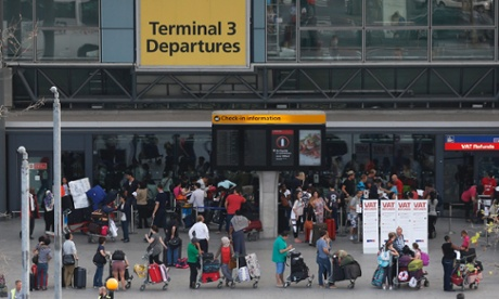 Passengers queue outside Terminal 3 at Heathrow Airport in London, Friday.