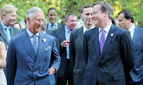 Prince Charles (left) and David Cameron chat during a reception at Clarence House