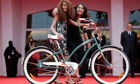Wadjda director Haifaa al-Mansour and actress Waad Mohammed pose with a bicycle