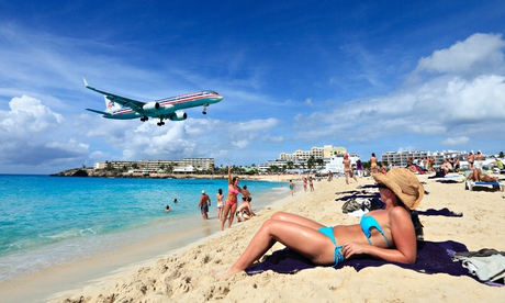 American Airlines Jet landing across the Maho beach at St.Maarten Princess Juliana Airport