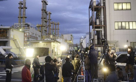 Press gather outside the chemical factory