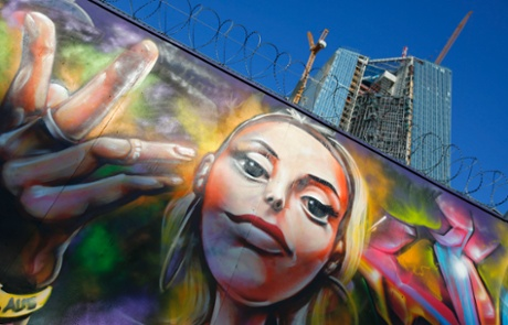 Graffiti is seen on a fence surrounding the construction site for the new headquarters of the European Central Bank (ECB) in Frankfurt August 28, 2013.