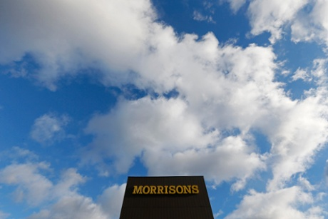 A Morrisons sign is seen outside a supermarket in London January 9, 2014.