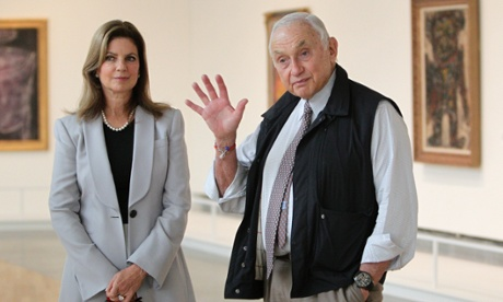 Retail mogul Leslie Wexner, right, and his wife Abigail tour the Transfigurations exhibit at the Wexner Center for the Arts Friday, Sept. 19, 2014