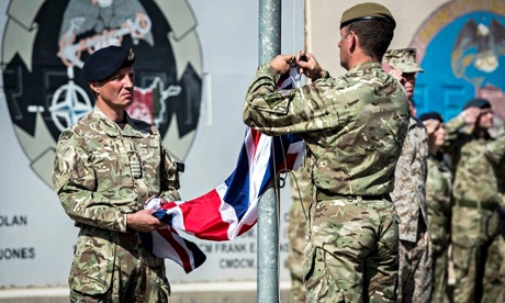 British soldiers lower the union flag at Camp Bastion, marking the formal end of combat operations i