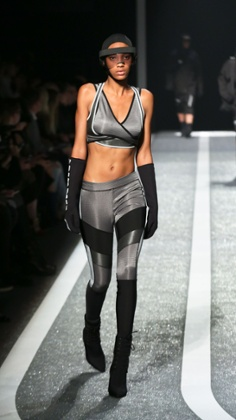 A model in full bodycon athleisure gear, courtesy of Alexander Wang for H&M.