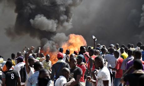 Smoke rises outside Burkina Faso's national assembley