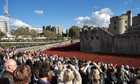 Visitors view the poppy artwork at the Tower of LOndon