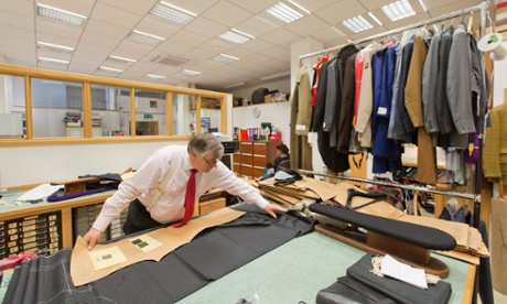 Peter Ward, production director at Dege & Skinner, Saville Row, making a suit.