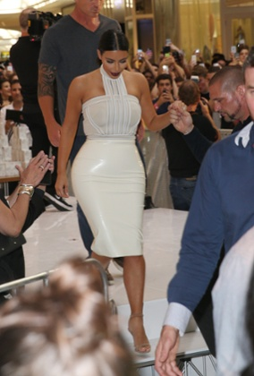 Kim Kardashian wearing a latex pencil skirt.