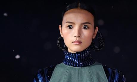model with black sequins glued to her eyelids